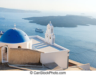 Blue domed church in Santorini - Classical Greek blue domed...