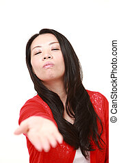 angry Japanese woman requests something - concept shot of...