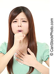 young Japanese woman coughing