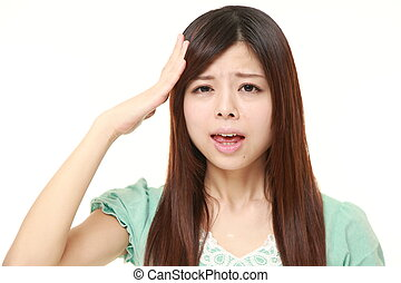 perplexed young Japanese woman
