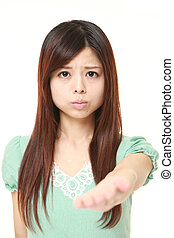 angry young Japanese woman requests something - portrait of...