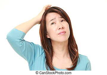 middle aged Japanese woman has lost her memory - studio shot...