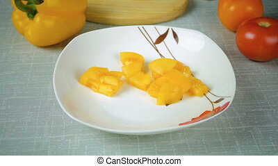Girl lays on a plate washed yellow sliced tomato - The girl...