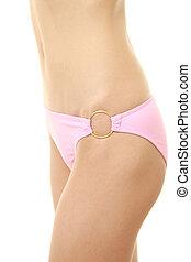 Body of young woman in a pink bikini