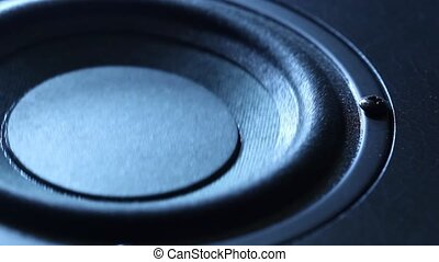 Closeup at moving sub-woofer. Speaker part. - Closeup at...