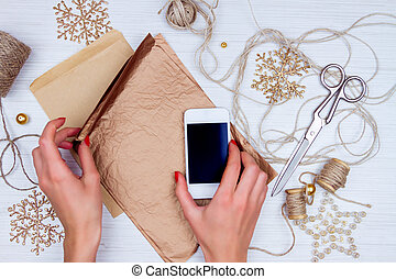 Preparation for christmas holidays - Girl wrapping up a...