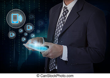 Businessman hand touch screen smartphone icons on a tablet. internet and technology concept.