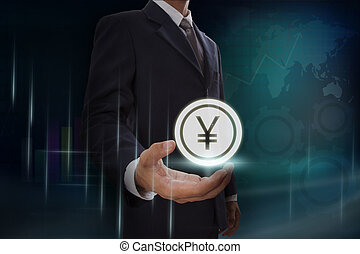 Businessman showing yen sign on screen. business concept