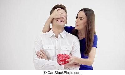 Happy young couple with Valentine's Day present