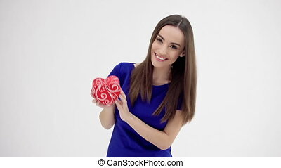 Beautiful woman holding heart shaped gift - Valentine's Day....