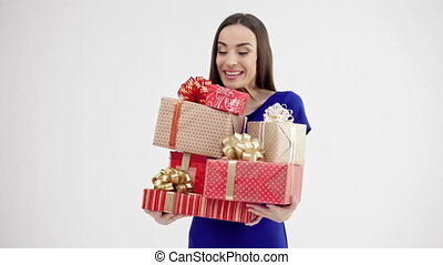 Woman holding group of gift boxes - Valentine's Day. Woman...