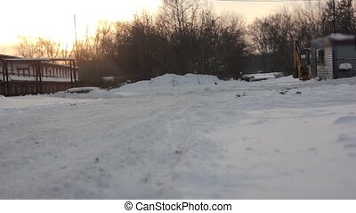 tractor cleans snow - Backhoe loader tractor clean local...