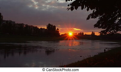 river bank sunset on the background of the uzgorod