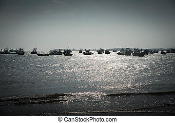 Sunset at the fisherman village - Silhouette of boats on the...