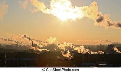Sun in smoke. Ekaterinburg, Russia