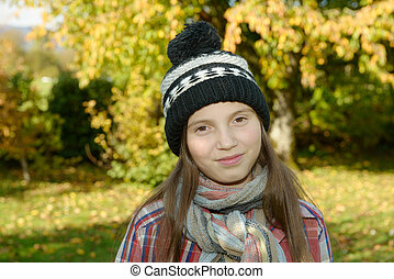 young pre teen with a winter cap, outdoors - young pre teen...
