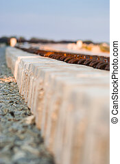Concrete railroad ties in railway construction site -...