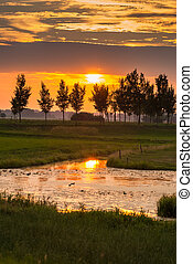 Amazing beautiful sunset along Dutch dikes - Sunset along...