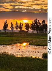 Amazing beautiful sunset along Dutch dikes - Sunset along...