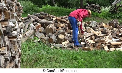 Strong gardener guy with hat prepare wood fuel and rural...
