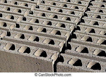 Construction hollow blocks - A row of newly made hollow...