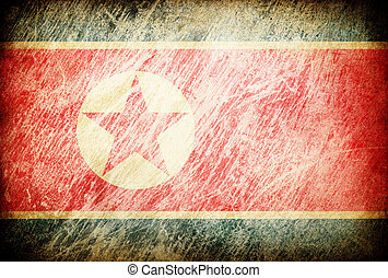 Grunge rubbed flag series of backgrounds. North Korea.