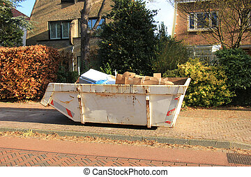 Loaded garbage dumpster - Loaded dumpster near a...