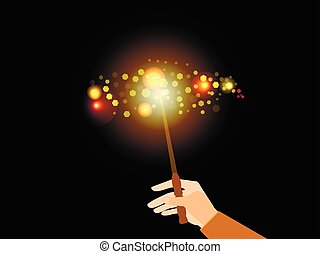 Hand holding a magic wand. Magic bright light with sparks....