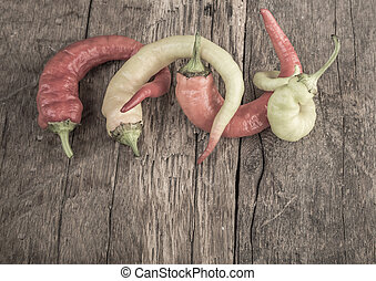 fresh peppers on wooden table - Soma fresh peppers on wooden...