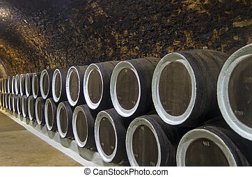 Oak barrels with wine in the winery sellars. Crimea. - Oak...