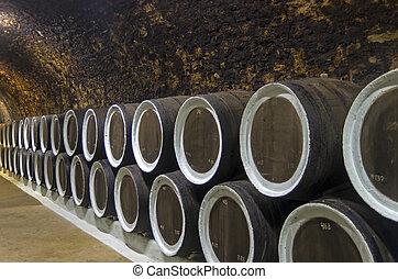 Oak barrels with wine in the winery sellars. Crimea. - Oak...