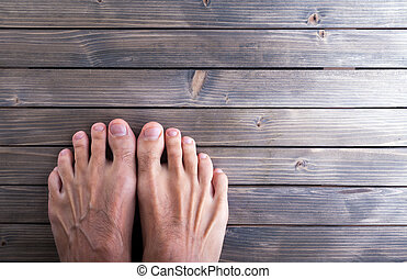 male feet on wooden background. - male feet on wooden...