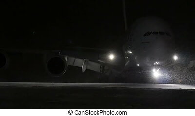 Airliner turns on the runway. At night, in the winter. -...