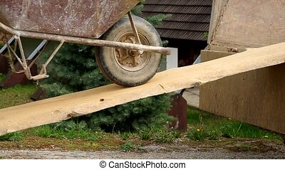 Wheelbarrow on thick boards - Waste disposal with...