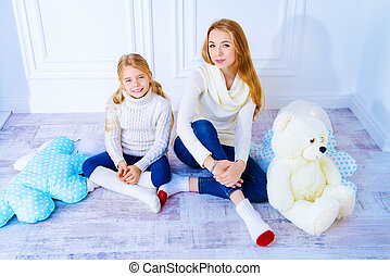 one family - Family portrait. Two cute girls, older and...