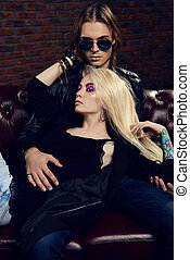 rock style people - Passionate young woman lying on the lap...