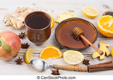 Natural flu and cold remedy - orange and lemon fruit, fresh ginger, honey.