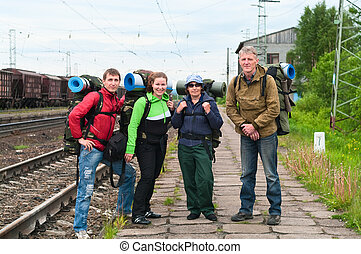 Group of travelers on railway station waiting a train....