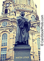 Frauenkirche (Our Lady church) and statue Martin Luther in...