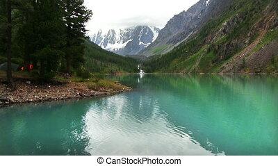 Lake And Peaks Reflecting In The Water - The top of the...