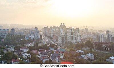 Sunset over the city of Alma-Ata. Kazakhstan. Panorama....
