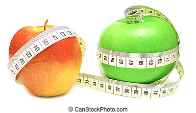 tape measure wrapped around green and red apple isolate on...