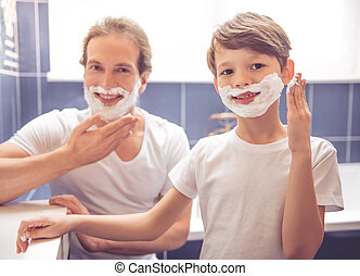 Father and son in bathroom - Father and son are applying...