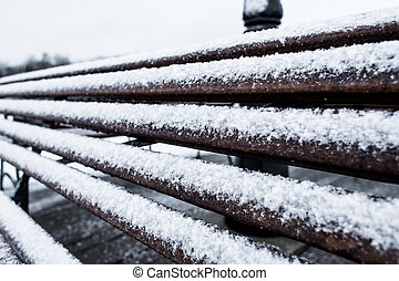 Closeup Frozen bench covered gritty rough hoarfrost on a...