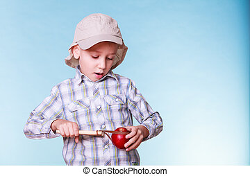 Young boy use sling shot hold apple. - Nature and free time...