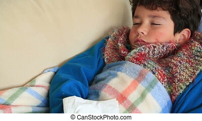 Child at home sick with flu, resting - Tired, weak boy at...