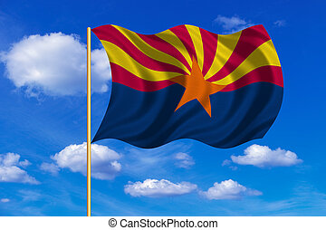 Flag of Arizona waving on blue sky background - Flag of the...