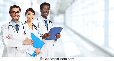 Doctors group. - Group of medical doctors over blue clinic...