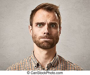 Scared man face. - Afraid surprised young caucasian man face...
