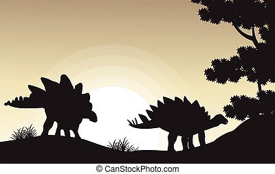 Silhouette of two stegosaurus scenery